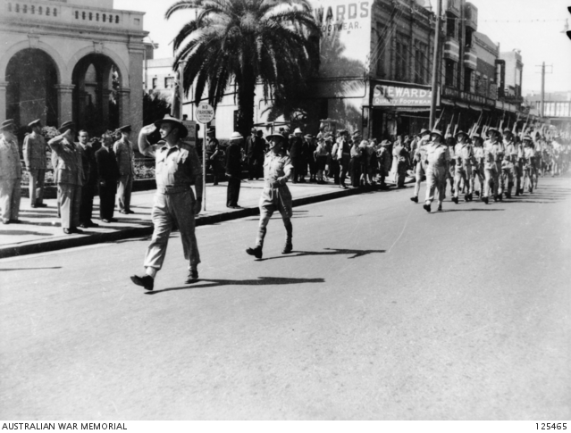 Major General H.W. Lloyd taking part in the salute from men of Second Army Headquarters in the Victory Loan March, Parramatta 1945