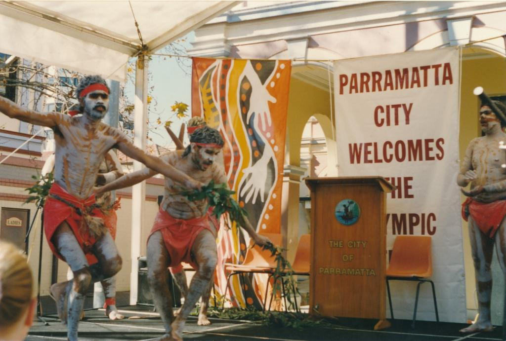 PRS118_086_001: Aboriginal dancers performing at the Olympic Flag in Parramatta ceremony, 1996 (City of Parramatta Council Archives)