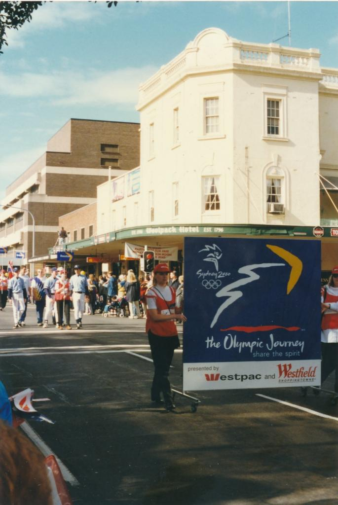 PRS118_090_002: Sydney 2000 banner at Olympics Parade in Parramatta, 1997 (City of Parramatta Council Archives)
