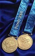 Victory medals for the Sydney 2000 Olympic Games (Image source: https://www.olympic.org/sydney-2000-medals)
