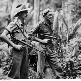 From left: Private Leon Ravet of Parramatta, and Private Bernard Kentwell of Cronulla, on the alert while on patrol duty with their Owen sub machine guns. Source: Australian War Memorial 018320