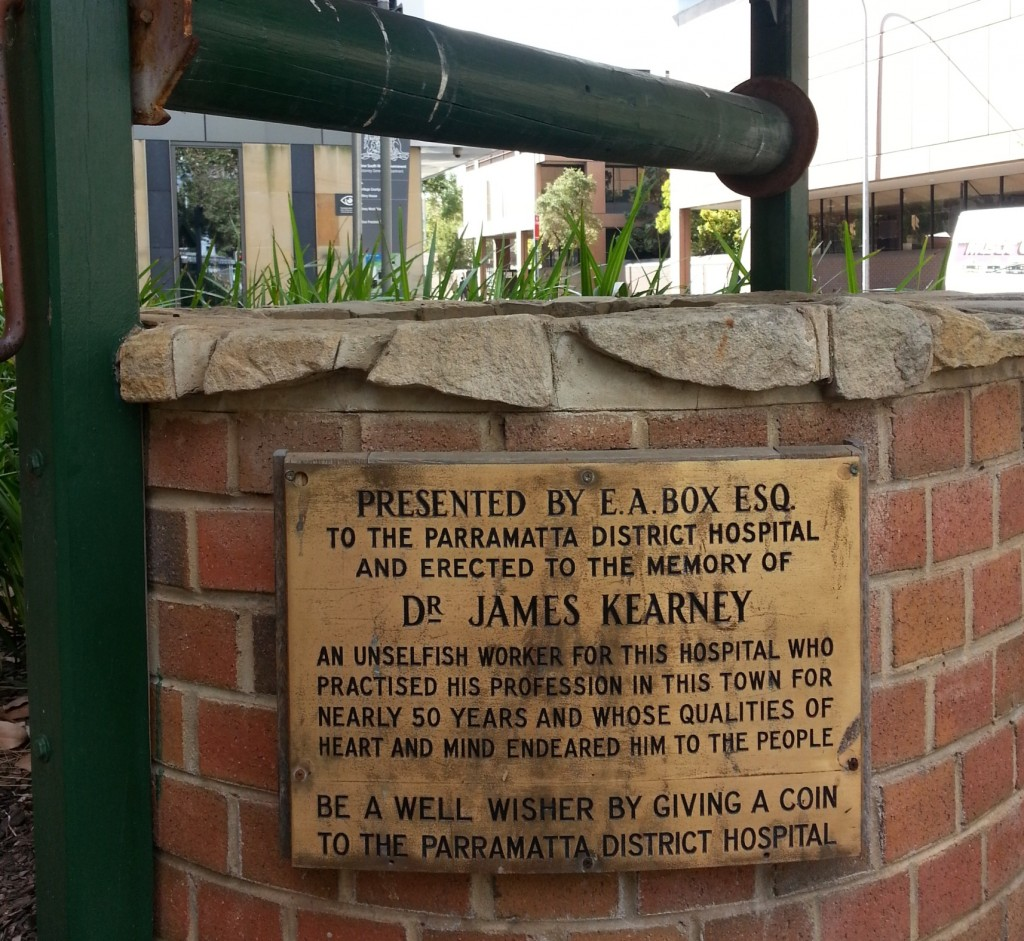 Original plaque dedicating the wishing pool to Dr Kearney