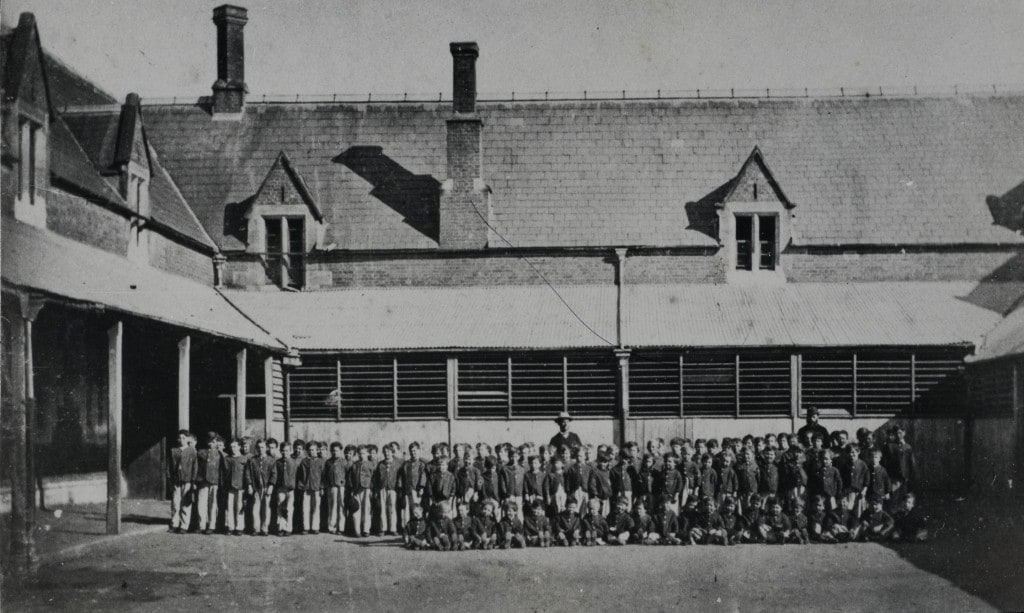 Roman Catholic Orphan School, Parramatta, view of orphan boys assembled in front of two storey building, ca. 1870. Parramatta Heritage Centre LSP650